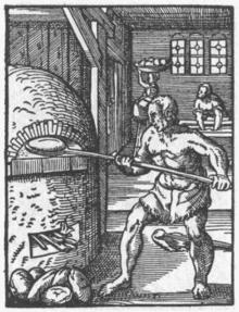 Bäcker, der Brot in den Ofen schiebt, 1568