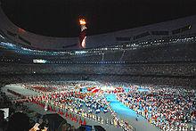 Atleten verzamelen zich in het stadion tijdens de sluitingsceremonie van de Olympische Zomerspelen 2008.