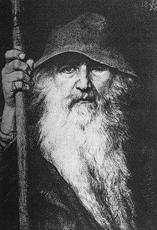 Een beeld van Odin de Zwerver, met grote hoed, vloeiende baard, mantel en staf.