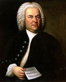 Johann Sebastian Bach in 1746, met nog een van zijn composities gebaseerd op de canon: zijn canon triplex a 6 voci, BWV 1076. Olieverfschilderij door Elias Gottlob Haussmann.