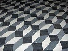 Bodenfliesen in der Lateranbasilika St. Johannes in Rom. Das Muster erzeugt eine Illusion von dreidimensionalen Kästen.