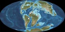 Kaart van de Aarde, 113 tot 93,9 miljoen jaar geleden. De witte stippen zijn spinosauride fossielen gedateerd op die periode