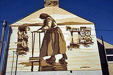 Muurschildering van Victoriaanse kokkelplukkers. Bij de ramp in Morecambe Bay in 2004 zijn ten minste 21 geïmmigreerde Chinese kokkelvissers verdronken door een opkomende vloed voor de kust van Lancashire/Cumbria.