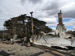 Bushfire schade aan een huis bij Steels Creek