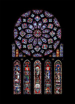 La rosa del transetto nord della cattedrale di Chartres. Rappresenta la Vergine Maria come Regina del Cielo, circondata da re e profeti biblici. La finestra comprende le braccia della Francia e della Castiglia
