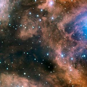 Een klein deel van de emissienevel NGC 6357. Het gloeit met het karakteristieke rood van een H II gebied.
