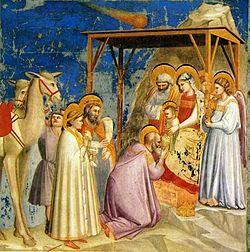 Матфей рассказывает, что мудрецы с Востока пришли принести драгоценные дары младенцу Иисусу (написано Джотто в 1300 г.)