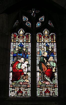 Окно церкви с историей Доброго Самарянина.