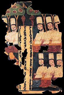 Manicheïsche priesters, die aan hun bureau schrijven, met een inscriptie in Oeigoer. Manuscript uit Khocho, Tarim Basin.