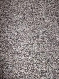 Een machinaal gepast tapijt